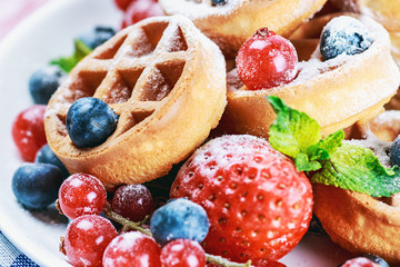 waffles with fresh strawberries, blueberries and red currants