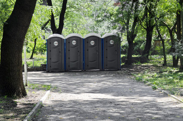 Portable public toilets outdoor in a row