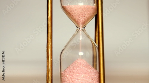 Sands move through hour glass