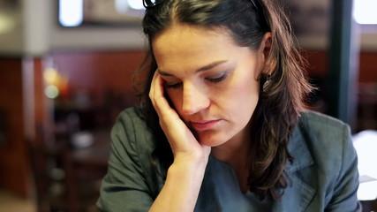 Sad businesswoman sitting in cafe, closeup, steadycam shot