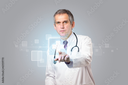 Doctor pressing modern medical type of button