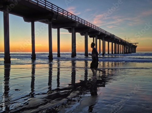 Evening Jogger at Scripps Pier in La Jolla, San Diego, CA, USA