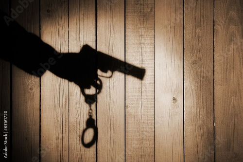 Male Hand with Gun and Handcuff on Natural Wood Background, XXXL