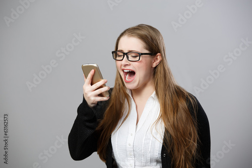 smart businesswoman shouts at phone