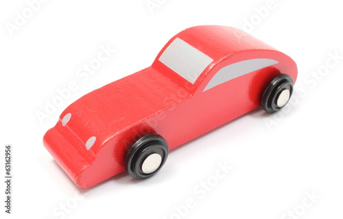 Red toy car isolated on white background
