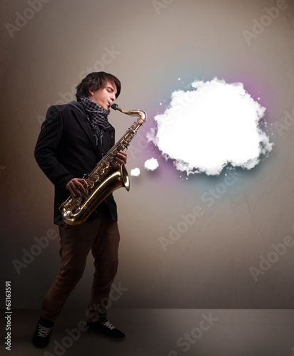 Leinwandbild Motiv Young man playing on saxophone with copy space in white cloud