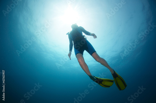 Free diver accending to the surface