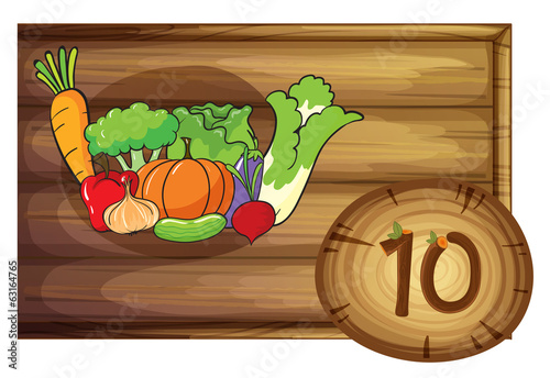 A wooden frame with ten vegetables