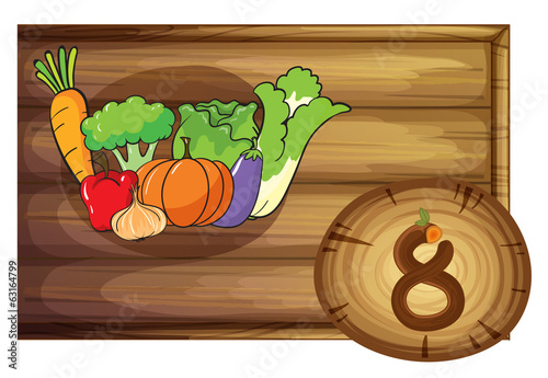 A wooden frame with eight vegetables