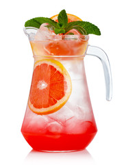 Full jug of fresh nonalcoholic cocktail with grapefruit and gree
