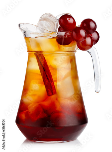 Full jug of fresh nonalcoholic cocktail with grapes and cinnamon