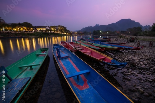 Traditional boats in Nam Song river at Vang Vieng, Laos