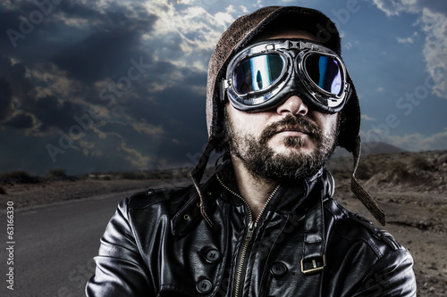 Pride biker with black leather jacket and old glasses