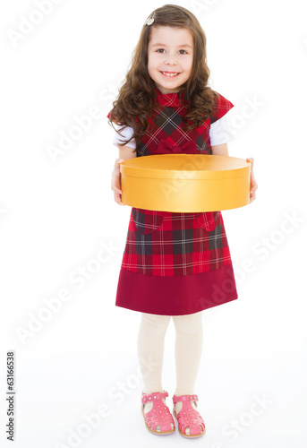 Young girl with big round box.
