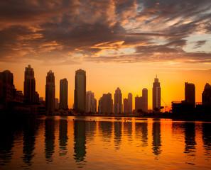 Dubai city with skyscrapers against sunset  United Arab Emirates