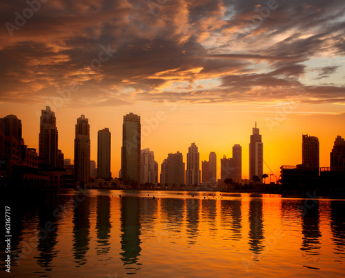 Dubai city with skyscrapers against sunset  United Arab Emirates