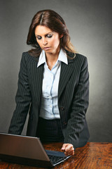 Attractive manager woman angry with the computer