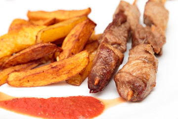 Pork skewers and French fries