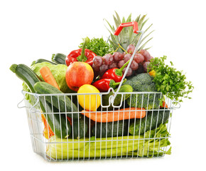Wire shopping basket with groceries isolated on white