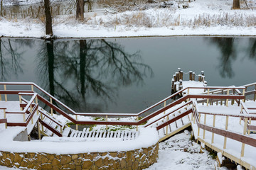 wooden staircase to the bottom in winter