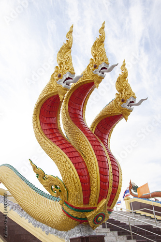 Golden three headed naga statue