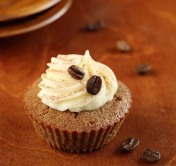 Tiramisu Cupcake on a wooden background