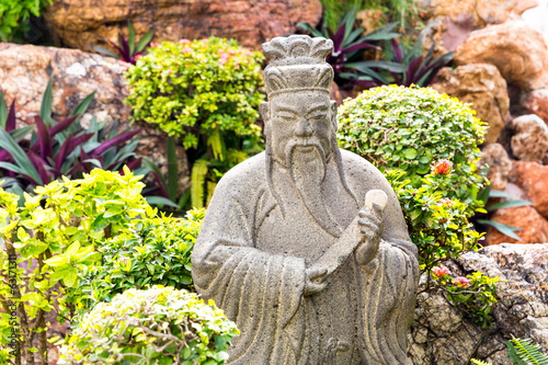 Wise man statue in garden