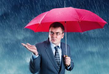 Office worker hiding under an umbrella