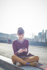 young beautiful hipster woman using smart phone