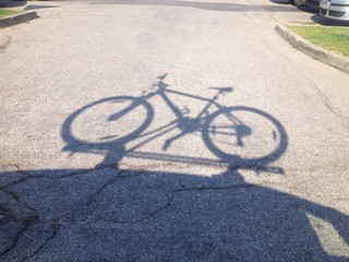 bicycle on car shadow