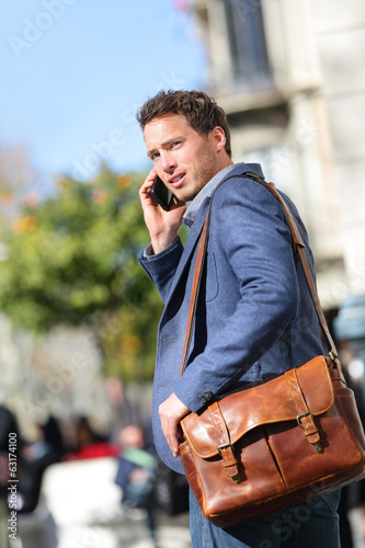 Business man on smart phone, Barcelona