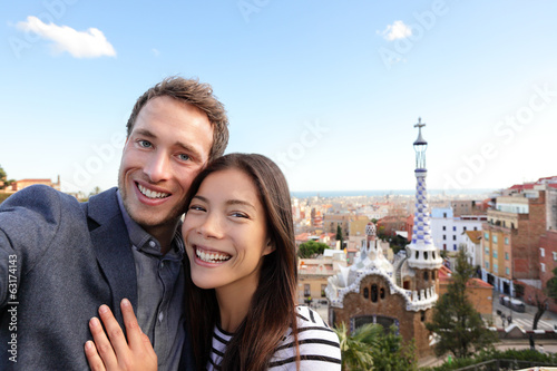Happy travel couple in Park Guell, Barcelona