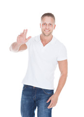 Friendly fit muscular young man in jeans and a t-shirt
