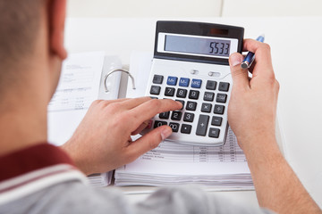 Man Calculating Financial Expenses