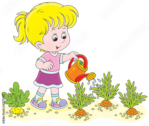 Little girl watering vegetables
