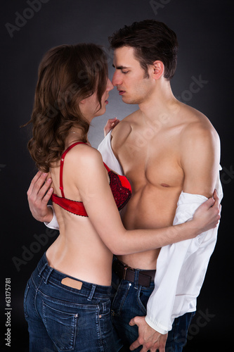 Lusty Woman In Bra Removing Man's Shirt