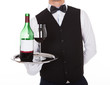 Waiter Holding Tray With Glass Of Red Wine And Bottle