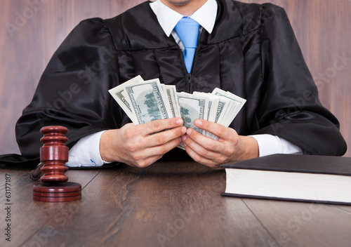 Judge Counting Money