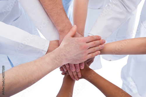 Doctors and nurses stacking hands