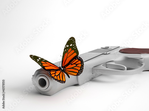 Closeup of butterfly on handgun | Concept war and peace