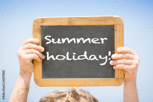 Text SUMMER HOLIDAYS on blackboard