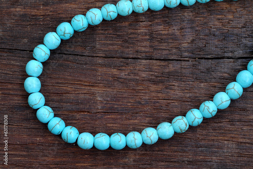 Turquoise bead on a wooden
