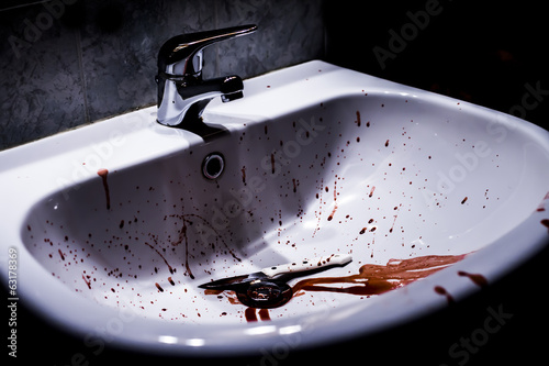 Suicide concept - blood and knife in a sink