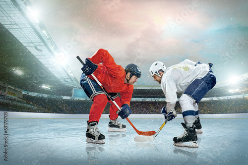 canvas print picture Ice hockey player on the ice. Open stadium - Winter Classic game