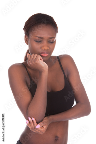 Young woman in undergarments suffering from elbow pain