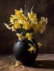 Beautiful daffodils in black vase