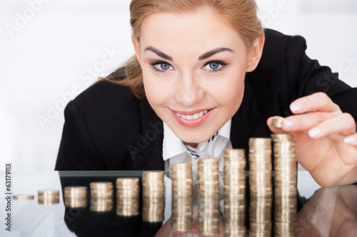 canvas print picture Businesswoman Stacking Coins