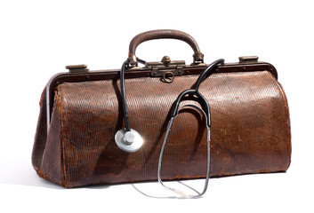 Old brown leather doctors bag and stethoscope