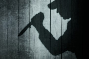 Human Silhouette with Knife in shadow on wooden background, XXXL
