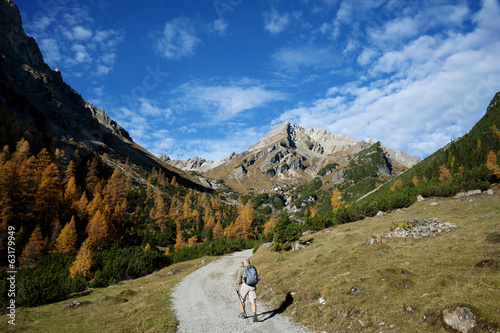 Autumn hiker in the Alps